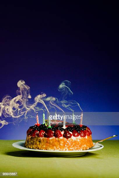Birthday cake with blown out candles.