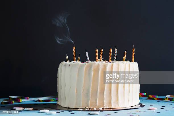 Birthday cake with blown out candles, still life.