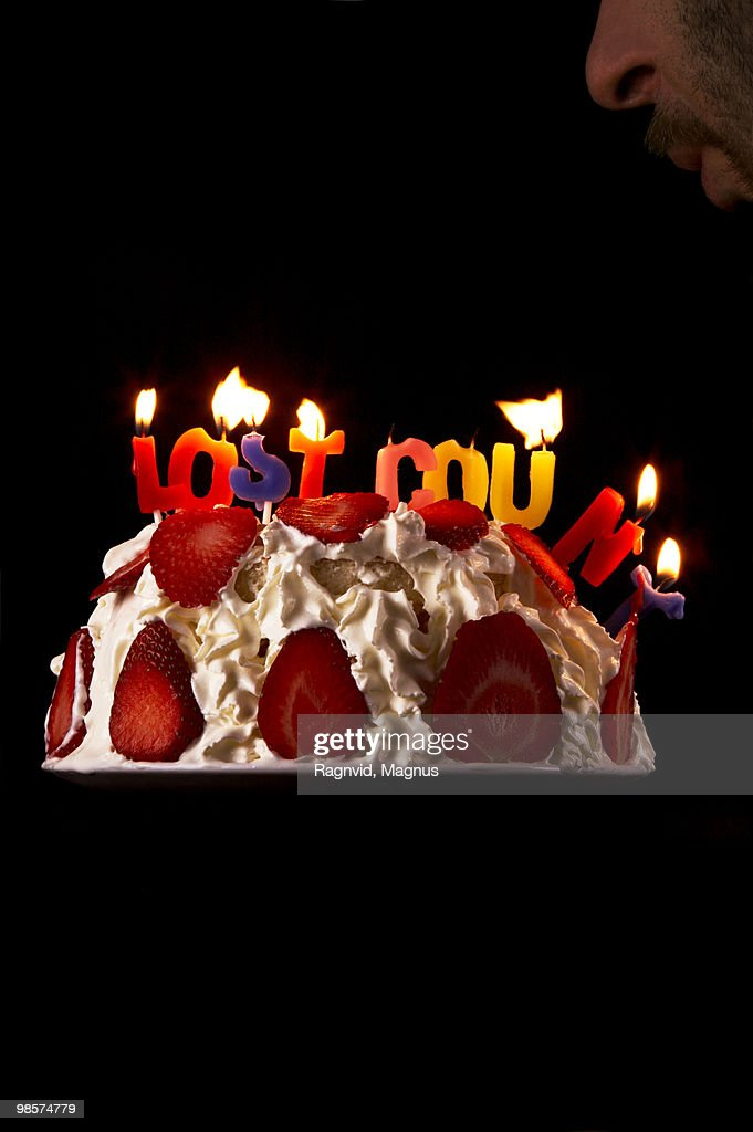 A birthday cake with burning candles. : Stock Photo