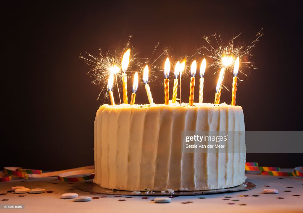Birthday cake with candles and sparklers. : Stock Photo