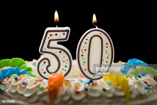 birthday cake with candles that say 50