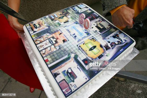A birthday cake with Cluedo on top which is celebrating its 60th anniversary