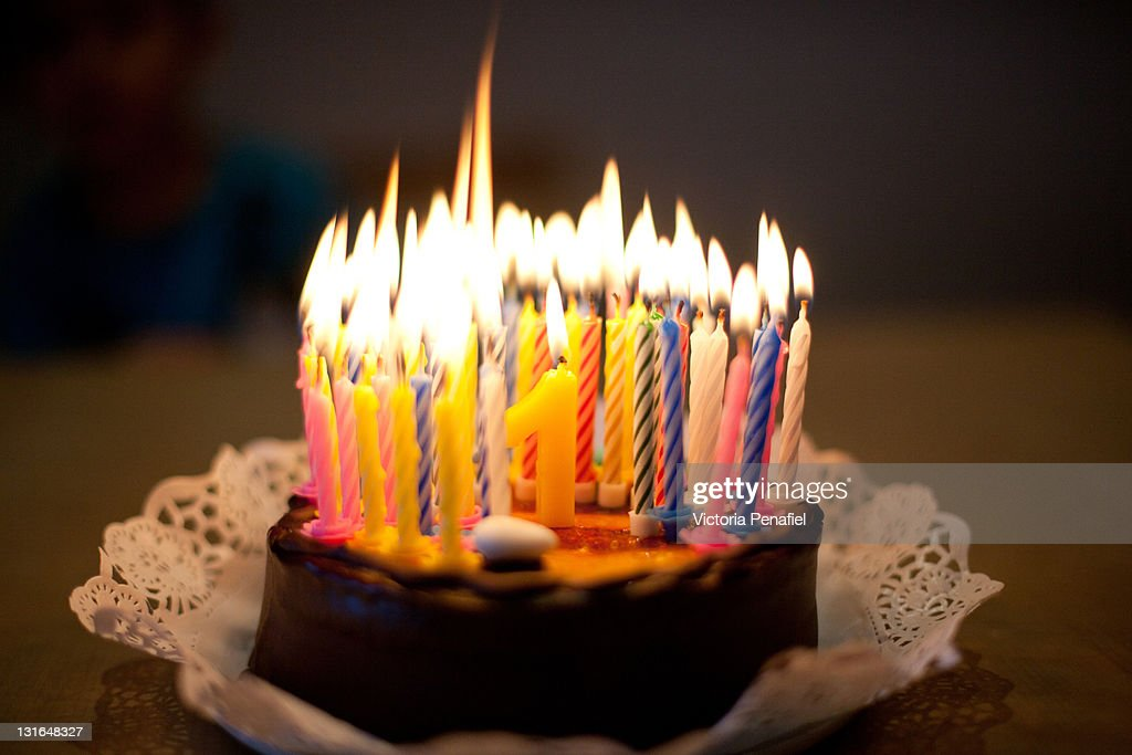 Images Birthday Cake Candles : Birthday Cake With Lit Candles Stock Photo Getty Images
