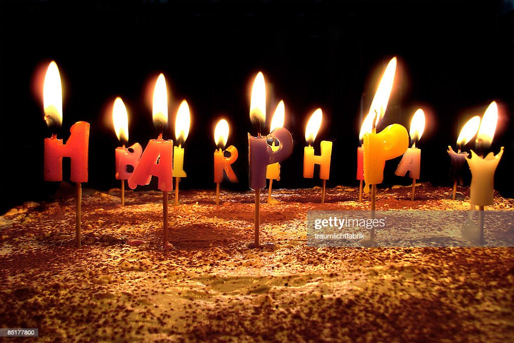 Birthday cake with lit candles : Stock Photo