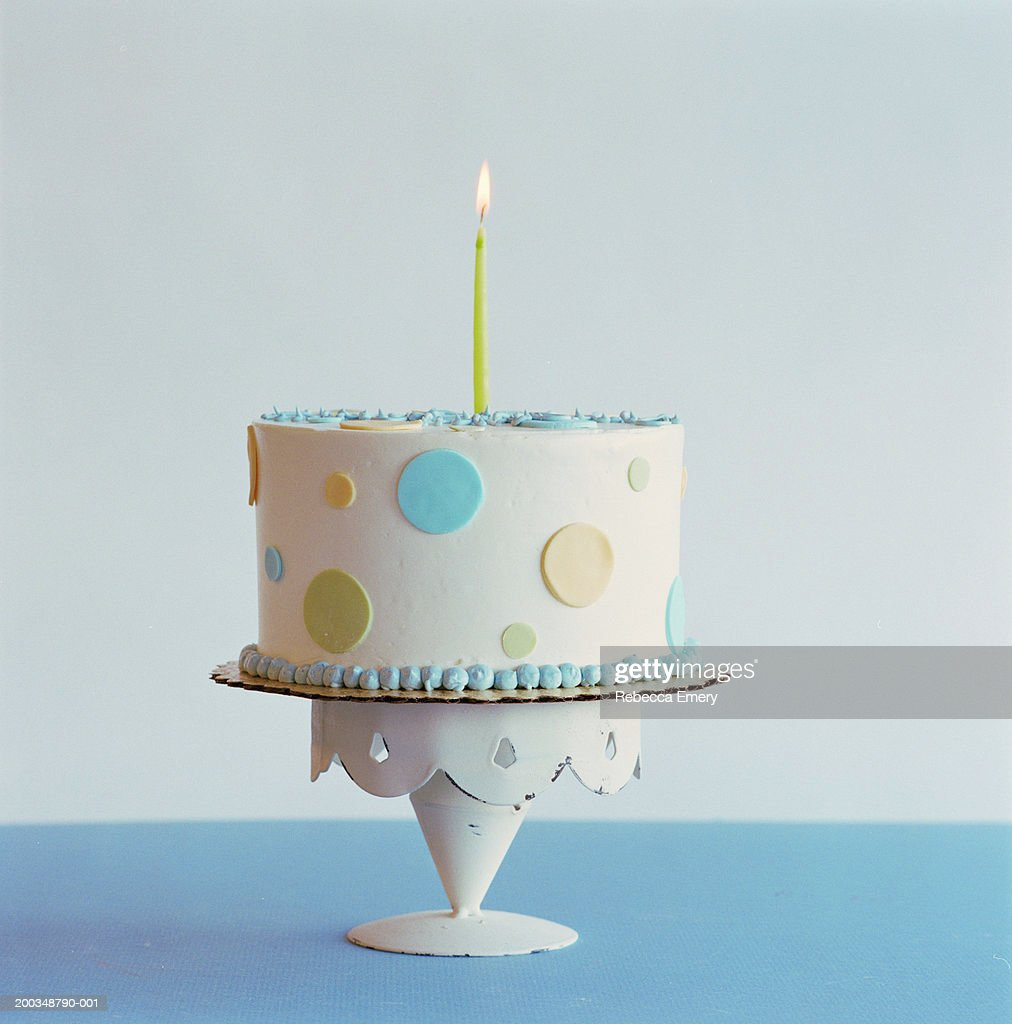 Birthday cake with one candle : Stock Photo