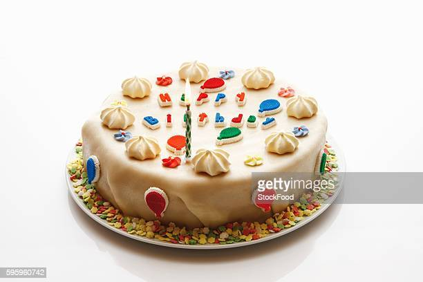 Birthday cake (marzipan-covered) with one candle