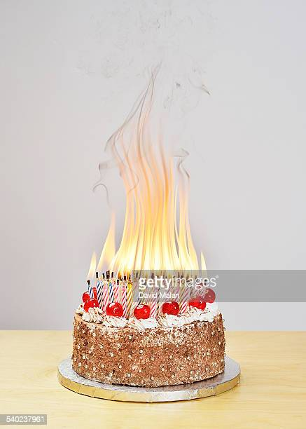 100 birthday candles burning on a cake