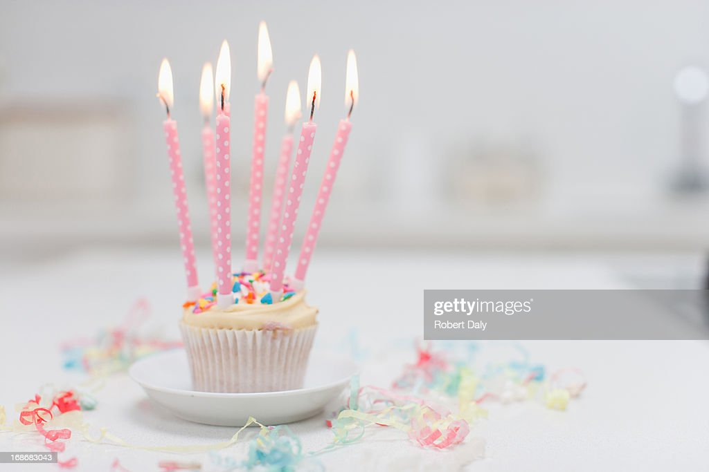 Birthday candles on cupcake