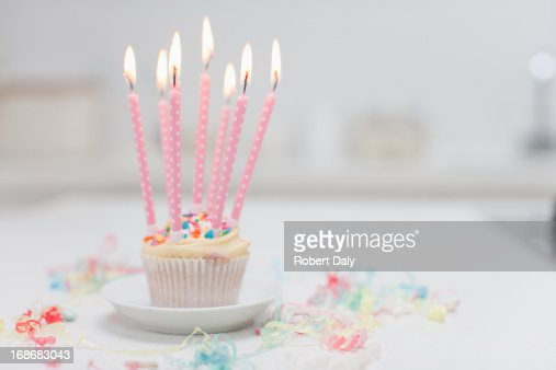 Birthday candles on cupcake : Stock Photo