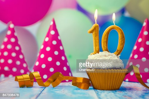 Birthday celebration with cupcake and candle : Stock Photo