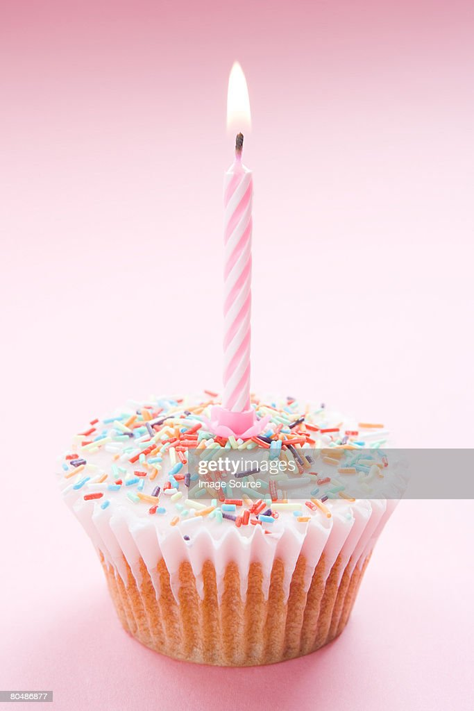A birthday cupcake : Stock Photo