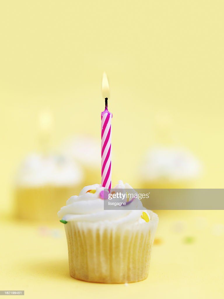 Birthday Cupcake With Candle Stock Photo | Getty Images