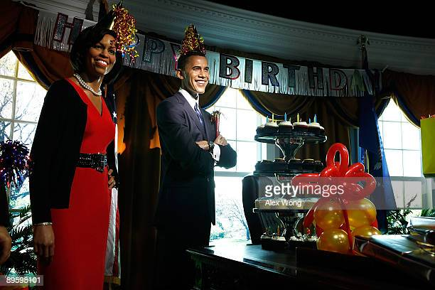 Birthday decorations are placed on the wax figures of US first lady Michelle Obama and President Barack Obama in a mock Oval Office at Madame...