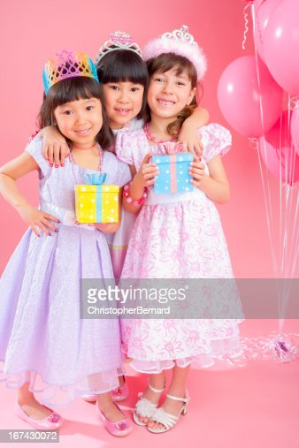 Birthday girl celebrating with friends : Stock Photo