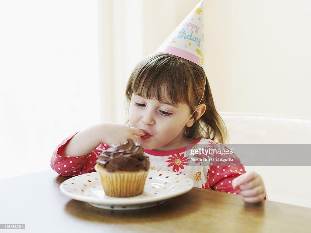 Birthday Girl Eating Cupcake : Stock Photo