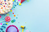 Colorful birthday party background with birthday cake and party hats