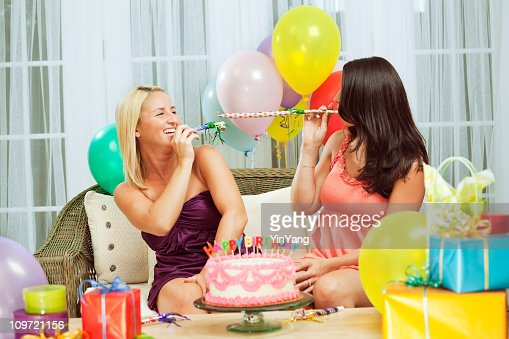 Birthday Party Two Young Women Friends With Noisemakers