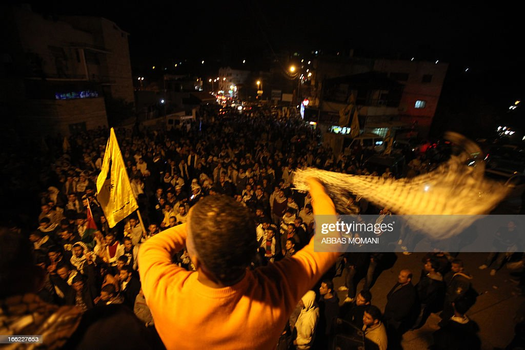 Birtzeit University students loyal to Fatah celebrate their victory over Hamas in the university elections, next to the Birzeit University campus near the West Bank city of Ramallah, on April 10, 2013. Fatah won 23 seats out of the 51, while Hamas won 20.