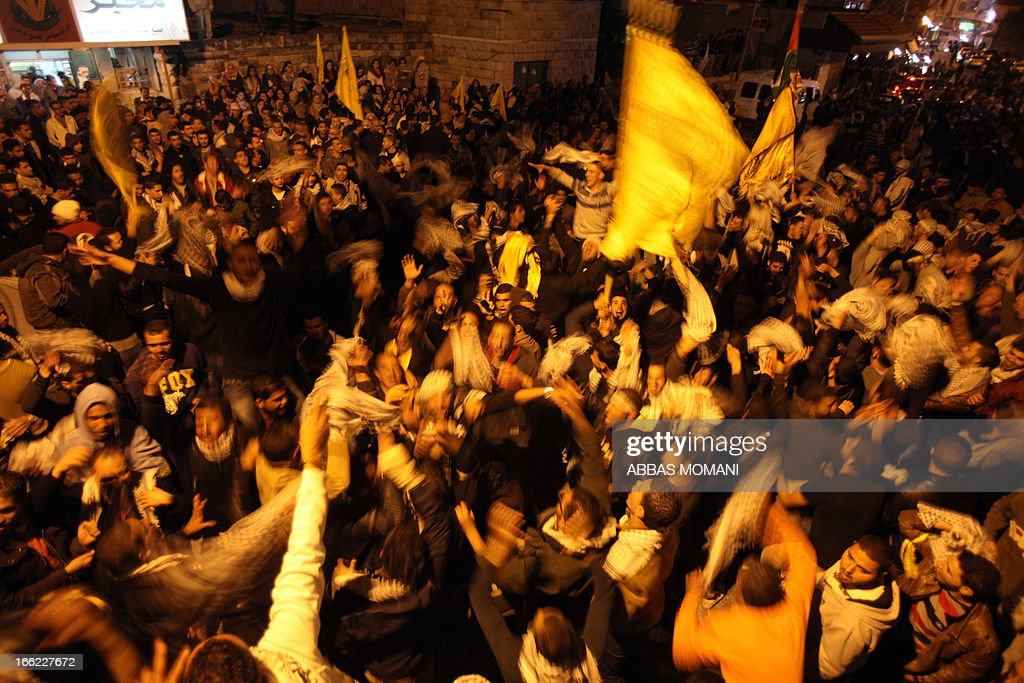 Birtzeit University students loyal to Fatah celebrate their victory over Hamas in the university elections, next to the Birzeit University campus near the West Bank city of Ramallah, on April 10, 2013. Fatah won 23 seats out of the 51, while Hamas won 20. AFP PHOTO/ABBAS MOMANI