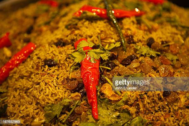 Biryani biriani beryani or beriani is a type of ricebased foods made with spices rice and meat fish eggs or vegetables The name is derived from the...