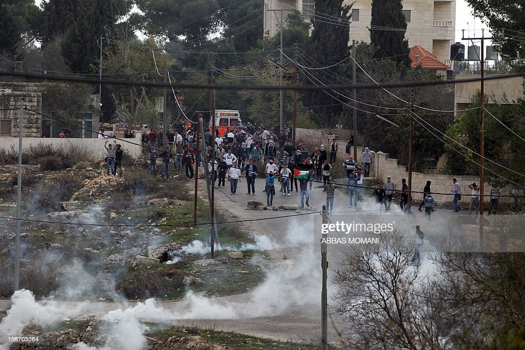 Birzeit University students clash with Israeli soldiers at the Atara checkpoint close to the university as they protest against Israel's military action on the Gaza Strip, on November 19, 2012. Israeli air strikes across the Gaza Strip killed 13 people, raising the Palestinian death toll to 90 as Israel's relentless air campaign entered its sixth day.