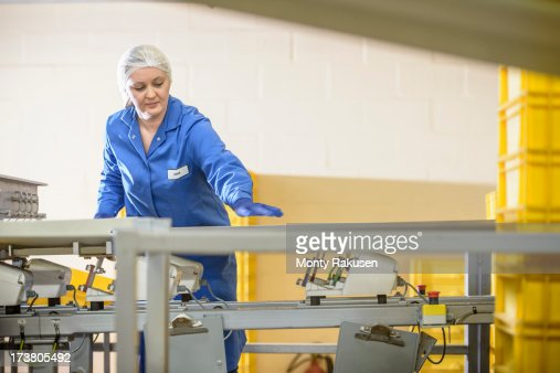Biscuit Factory Worker Inspecting Freshly Made Biscuits On – Production Worker