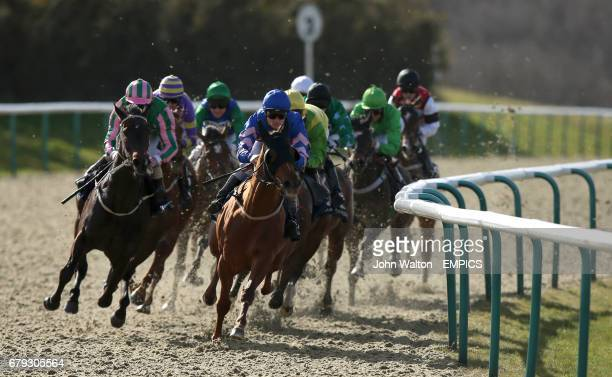 Biscuiteer ridden by Frederik Tylicki rounds the bend before going into the home straight and winning The 32red Thunderstruck II Slot Casino Handicap