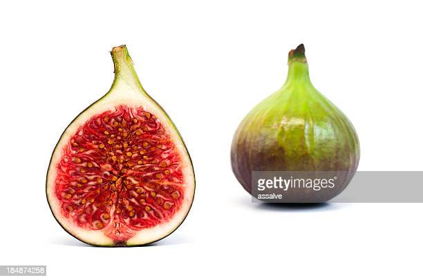 bisected and whole fig fruit isolated on white