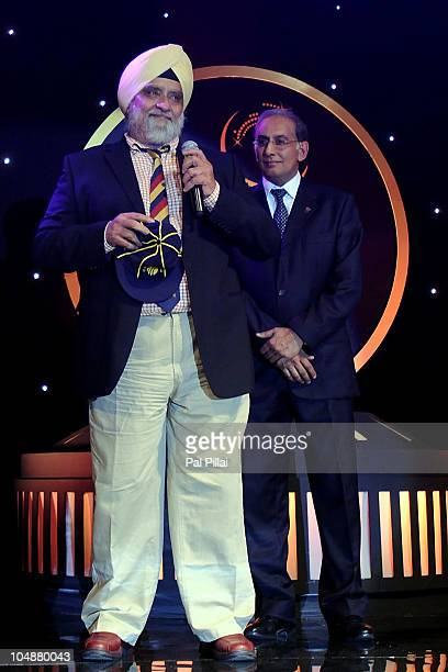 Bishan Singh Bedi receives the Hall of Fame award from Haroon Lorgat the CEO of ICC during the ICC Annual Awards at the Grand Castle on October 6...