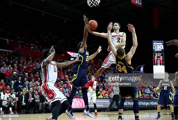 Bishop Daniels of the Rutgers Scarlet Knights drives for a shot attempt against Aubrey Dawkins of the Michigan Wolverines during their Big Ten...