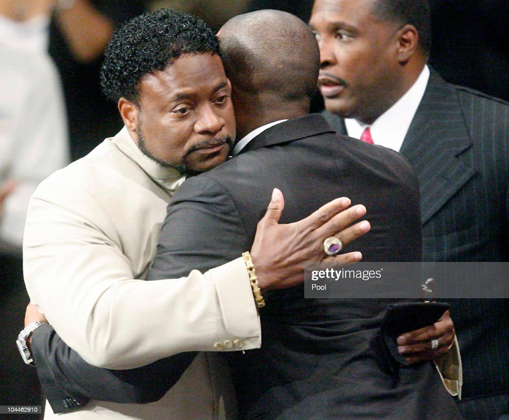 Bishop Eddie Long (L) embraces a friend, at the New Birth Missionary Baptist Church September 26, 2010 in Atlanta, Georgia. Bishop Eddie Long, the pastor of a Georgia megachurch was accused of sexual coersion by three men whom were members of the New Birth Missionary Church. Long has said that he denies all the allegations and that all people must face painful and distasteful situations.