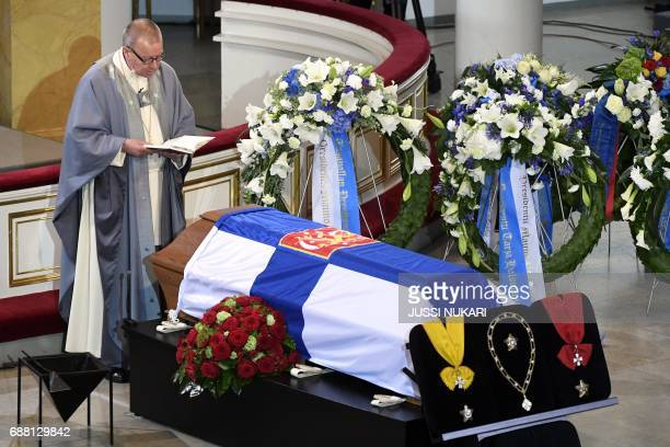 Bishop emeritus Eero Huovinen holds the funeral service next to the coffin of Finland's former President Mauno Koivisto at the Cathedral in Helsinki...