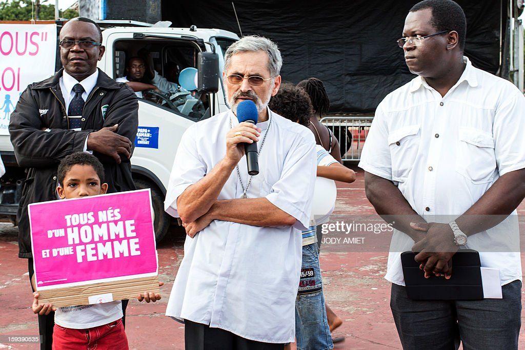 Bishop Emmanuel Lafont (C) addresses the crowd during a protest against same-sex marriage, in Cayenne, in French Guiana, on January 12, 2013. Tens of thousands are set to march in Paris, on January 13, 2013 to denounce government plans to legalise same-sex marriage and adoption which have angered many Catholics and Muslims, France's two main faiths. The French parliament is to debate the bill -- one of the key electoral pledges of Socialist President at the end of this month. AFP PHOTO/JODY AMIET