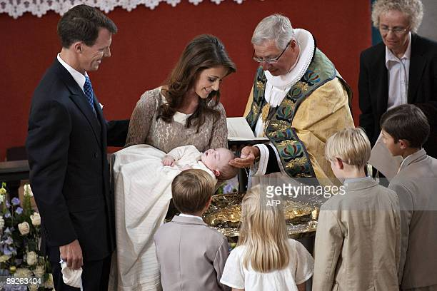 Bishop Erik Norman Svendsen christens the three month old son of Prince Joachim of Denmark and Princess Marie on July 26 2009 in Mogeltonder Church...