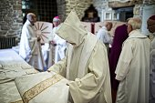 A bishop gets ready before the 'Grand Pardon' religious procession on July 26 2016 in SainteAnned'Auray western France This Catholic pilgrimage which...