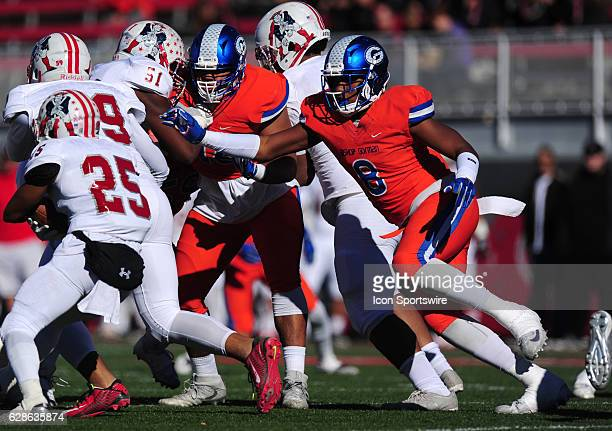 Bishop Gorman defensive end Adam Plant Jr looks to tackle Liberty Patriots fullback Joey Mazzara in the first half of the NIAA class 4A championship...
