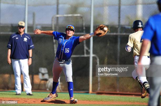 Bishop Gorman Gaels first baseman Austin Wells high has trouble fielding an offtarget throw to first base during their prep baseball game against the...