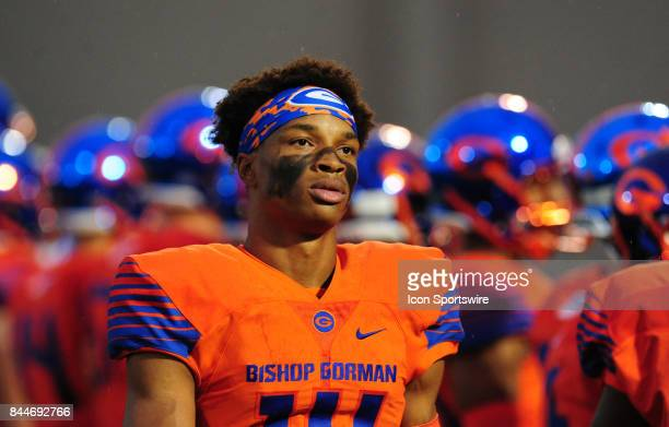 Bishop Gorman quarterback Dorian ThompsonRobinson looks on before the start of a prep football game between the Miami Central Rockets and the Bishop...