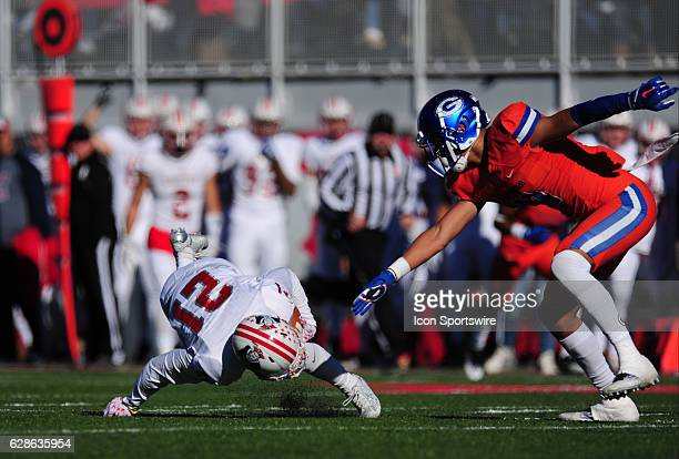 Bishop Gorman safety Bubba Bolden tackles Liberty Patriots wide receiver Darion Acohido in the first half of the NIAA class 4A championship game at...