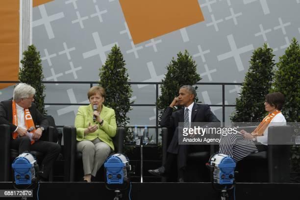 Bishop Heinrich BedfordStrohm German Chancellor Angela Merkel Former US President Barack Obama and Kirchentag President Christina Aus der Au attend...