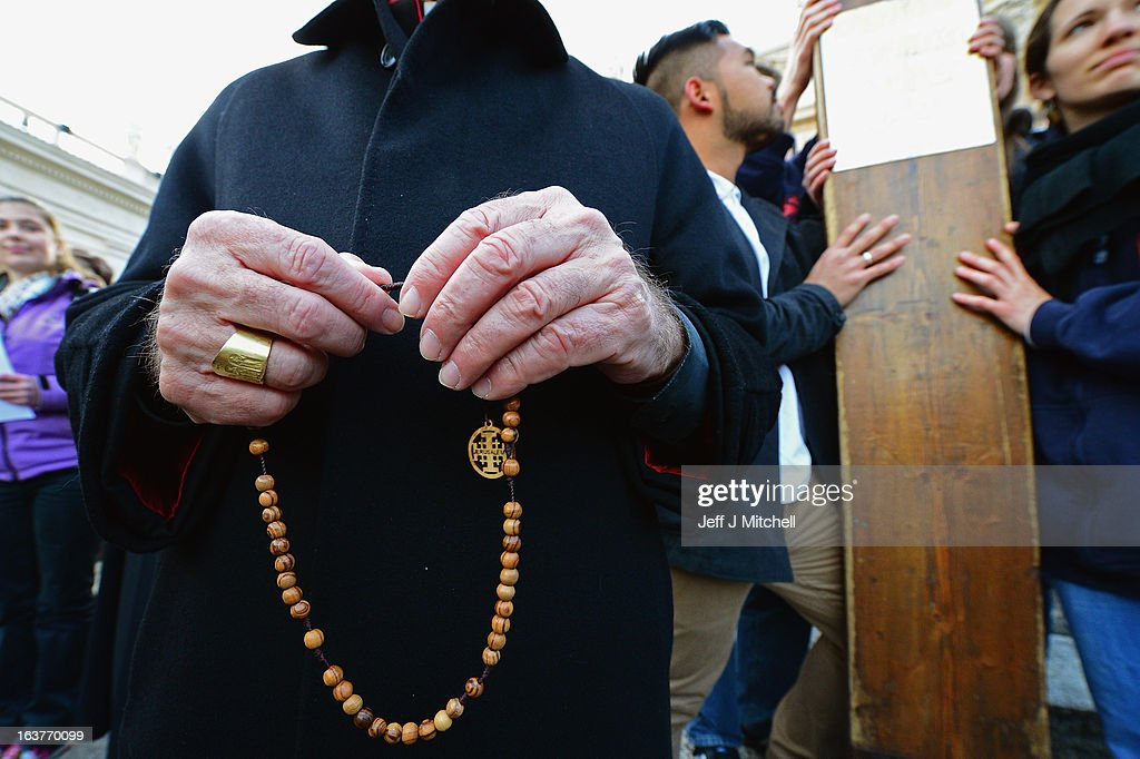 A bishop holds rosary beads in St Peter's Square on March 15, 2013 in Vatican, Vatican City. The inauguration mass of Pope Francis, the first ever Latin American Pontiff, will be held on March 19, 2013 in Vatican City. The Pope met with cardinals earlier on his second day as Pontif.