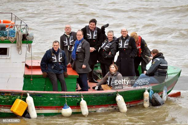 Bishop John Arnold Bishop Jonathan Clark Simon Hughes MP Rob Flello MP Sister Margaret Baxter Sarah Teather MP and Pat Browne on the river Thames in...