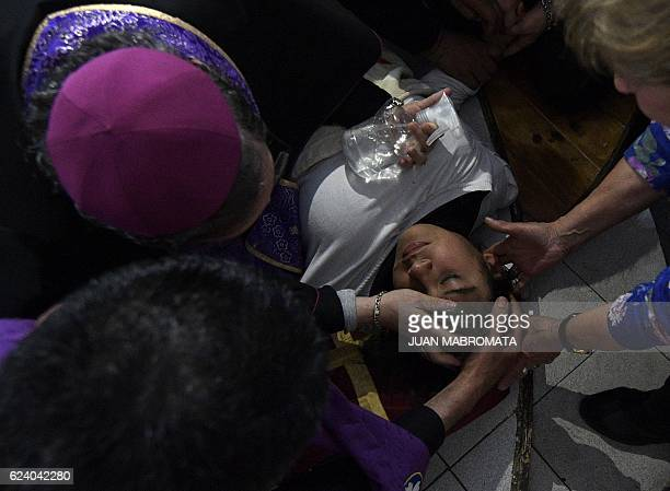 Bishop Manuel Acuna performs a ritual at the 'El Buen Pastor' parish in Santos Lugares outskirts of Buenos Aires on September 6 2016 Acuna who...