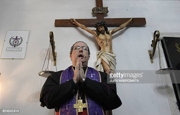 Bishop Manuel Acuna sprinkles holy water on a woman during a ritual at the 'El Buen Pastor' parish in Santos Lugares outskirts of Buenos Aires on...