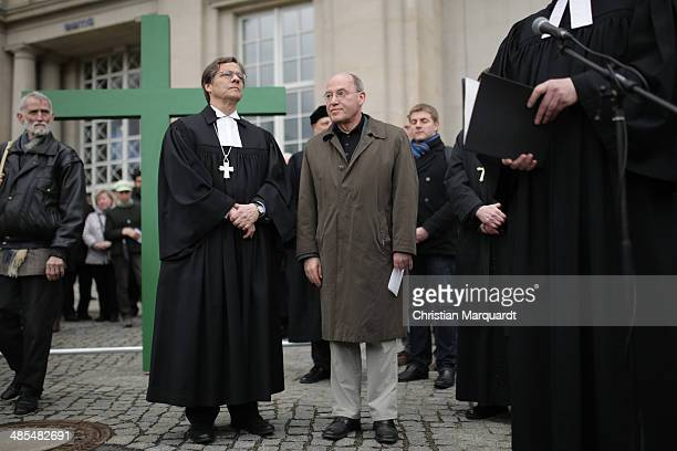 Bishop Markus Droege and fraction Leader Gregor Gysi 'Die Linke' stand together during the ecumenical Good Friday procession on April 18 2014 in...
