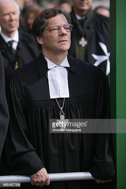 Bishop Markus Droege is seen as he carries a wooden cross during the ecumenical Good Friday procession on April 18 2014 in Berlin Germany Under the...
