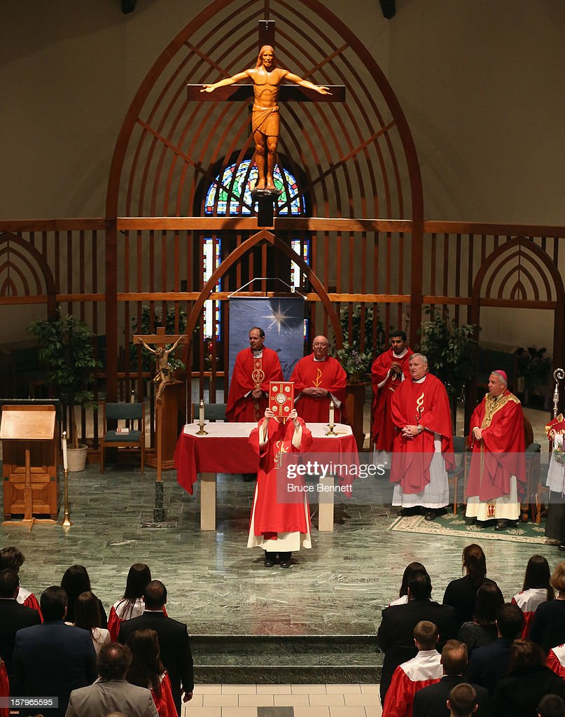 Bishop Nelson J. Perez officates over The Sacrament of Confirmation ceremony at The Church of St. Martin of Tours on December 7, 2012 in Bethpage, New York.