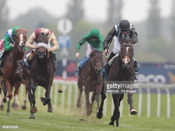 Bishop Roko ridden by James Doyle wins the Bet on your Mobile at bluesqcom EBF Maiden stakes during the Best of British Beer Festival JLT Lockinge...