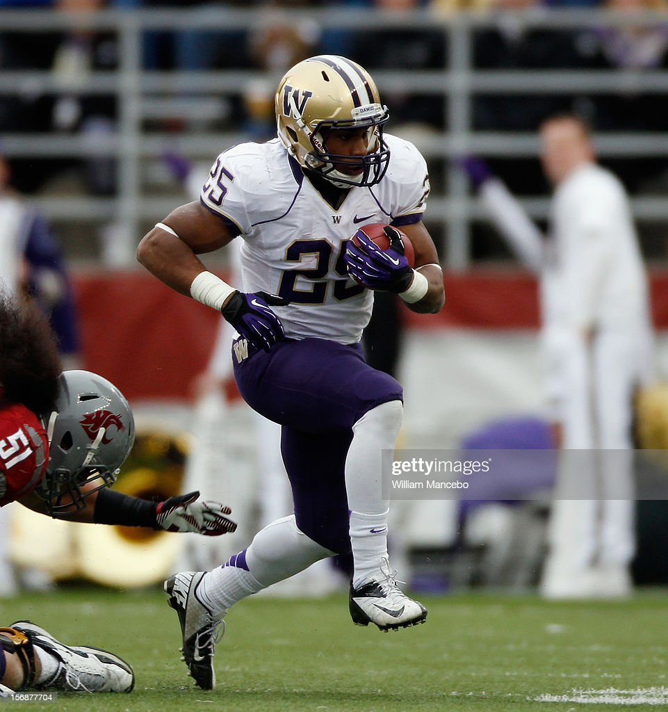 Bishop Sankey #25 of the Washington Huskies carries the ball during the game against the Washington State Cougars at Martin Stadium on November 23, 2012 in Pullman, Washington.