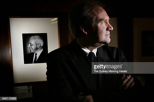 Bishop Tom Frame author of The Life and Death of Harold Holt with a portrait of Prime Minister Holt in the background at Old Parliament House...